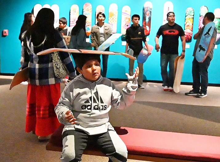 Ellis-Ray Uqualla  learning balance at the Museum of Northern Arizona March 21 at the Pivot exhibit. Uqualla and other Havasupai and Yavapai-Apache students attended an 'Expressions of Hope art workshop' to learn about the healing process of art and creative expression. (Photo/Museum of Northern Arizona)