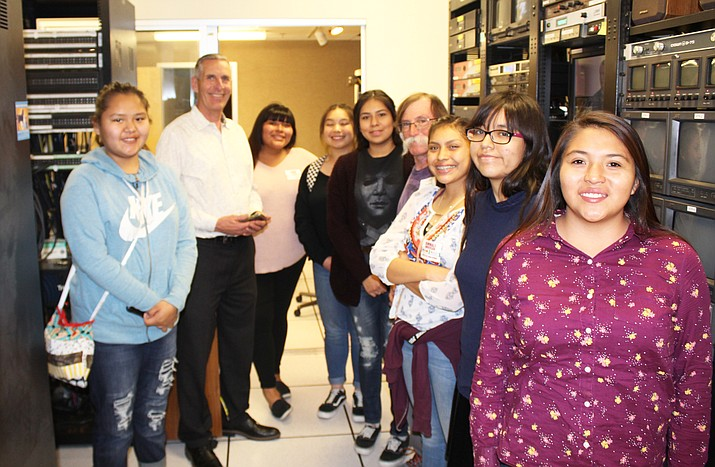 Hopi High media students visit the KNOW TV studios in Phoenix. From left: Dalilah Tsosie, KNOW Station Manager Chuck Emmert, Aubrey Harvey, Jacque Thorpe, Amber Labahe, media teacher Stan Bindell, Kimmale Anderson, Cierra Brady and Latifah Huma.  (Stan Bindell/NHO)