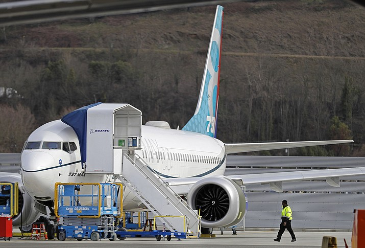 This Thursday, March 14, 2019, file photo shows a Boeing 737 Max 8 airplane parked at Boeing Field in Seattle. America's standing as the model for aviation-safety regulation will be on trial as congressional hearings begin Wednesday, March 27, 2019, into the Federal Aviation Administration's oversight of Boeing before and after two deadly crashes of its best-selling airliner. (Ted S. Warren/AP, File)