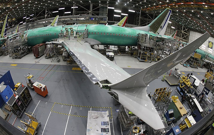 In this photo taken with a fish-eye lens, a Boeing 737 MAX 8 airplane sits on the assembly line during a brief media tour in Boeing's 737 assembly facility, Wednesday, March 27, 2019, in Renton, Wash. The Federal Aviation Administration plans to revamp oversight of airplane development after the two deadly crashes of Boeing's new 737 Max 8 airplane, according to testimony prepared for a Capitol Hill hearing on Wednesday. (Ted S. Warren/AP)