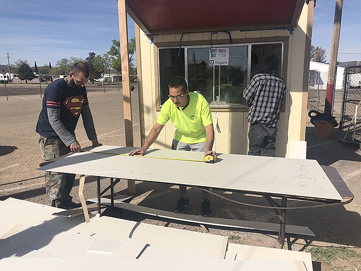 Workers at the Mohave County Fairgrounds were busy at their tasks Thursday, March 28, 2019. (Photo by Agata Popeda/Daily Miner)