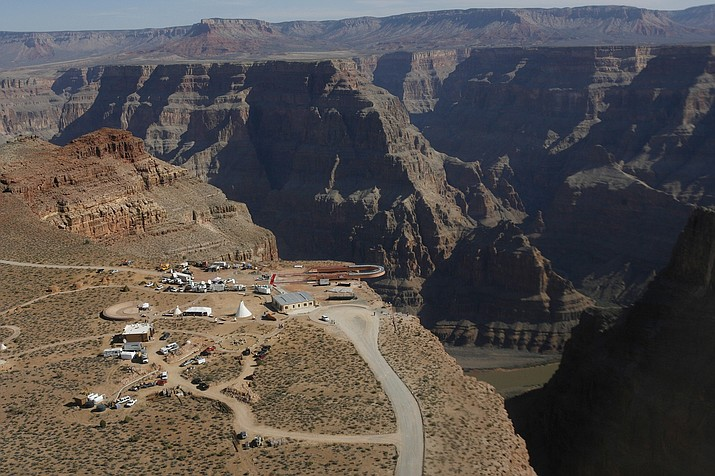The Skywalk hangs over the Grand Canyon on the Hualapai Indian Reservation before its grand opening ceremony March 20, 2007, at Grand Canyon West. A tourist slipped and fell over the edge of a Grand Canyon lookout on tribal land on Thursday, March 28, 2019. (Ross D. Franklin/AP, File)