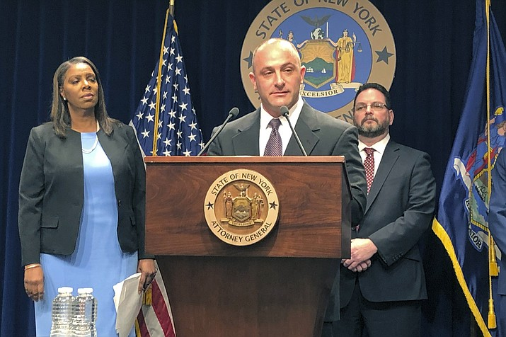 Justin Sangeorge, a social worker and recovering opioid addict, speaks at a news conference, Thursday, March 28, 2019, about a New York state lawsuit against opioid drug manufacturers and distributors. Behind him are New York Attorney General Letitia James, left, and drug abuse treatment center director Gary Butchen. (Jennifer Peltz/AP)