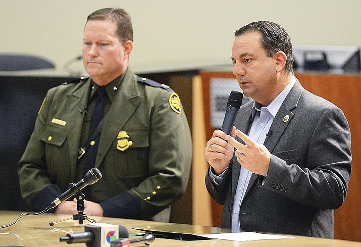 Yuma Mayor Doug Nicholls, right, answers a question during his news conference inside Yuma City Council Chambers about the current humanitarian crisis in the border region due to high volumes of illegal migrant crossing on Thursday, March 28, 2019, in Yuma. U.S. Border Patrol Deputy Chief Patrol Agent for the Yuma Sector, Carl Landrum, is on the left. (Randy Hoeft/The Yuma Sun via AP)