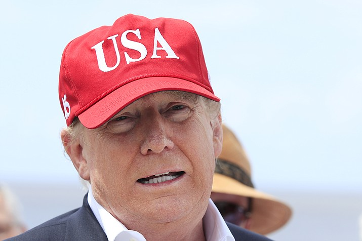 President Donald Trump speaks to reporters during a visit to Lake Okeechobee and Herbert Hoover Dike at Canal Point, Fla., Friday, March 29, 2019. Trump says he will close the nation's southern border, or large sections of it, next week if Mexico does not immediately stop illegal immigration. In a tweet, Trump ramped up his repeated threat to close the border by saying he will do it next week unless Mexico takes action. (Manuel Balce Ceneta/AP)