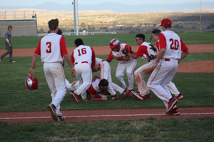 The Mingus Marauders celebrate their 5-4 inning walk off win over Bradshaw Mountain on Tuesday. VVN/James Kelley