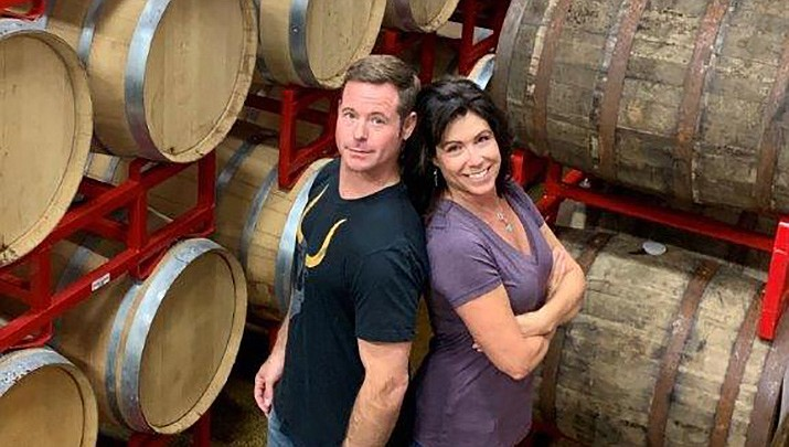 Jennifer and Jeff Herbert pose with their Meade Brewing in their warehouse. (Superstition Meadery/Courtesy)
