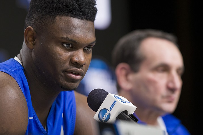 Duke forward Zion Williamson speaks, accompanied by head coach Mike Krzyzewski, during an NCAA men's college basketball news conference in Washington, Saturday, March 30, 2019. Duke plays Michigan State in the East Regional final game on Sunday. (Alex Brandon, AP)