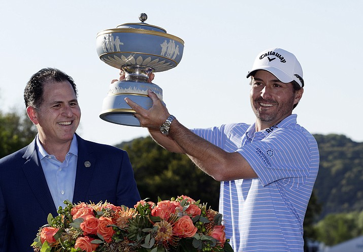 Kevin Kisner, right, holds his trophy presented by Michael Dell, CEO of Dell Technologies, after he defeated Matt Kuchar in the finals at the Dell Technologies Match Play Championship golf tournament, Sunday, March 31, 2019, in Austin, Texas. (Eric Gay, AP)