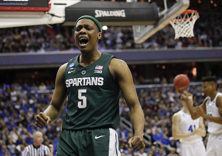 Michigan State guard Cassius Winston (5) reacts to scoring on Duke during the first half of an NCAA men's East Regional final college basketball game in Washington, Sunday, March 31, 2019. (Alex Brandon, AP)