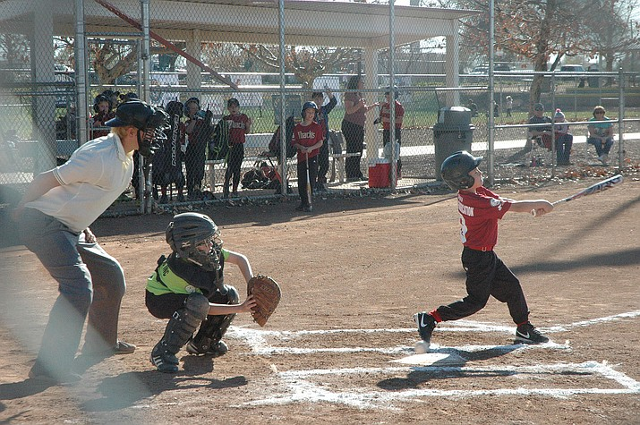 Hector Luis on the Johnson Fabrication team swings the bat in the team's first game of the season against the Chino Glass team during the Chino Valley Little League's opening day at Community Center Park Saturday, March 30. (Jason Wheeler/Courier)