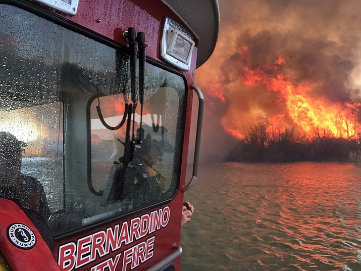 A San Bernardino County Fire Department boat gets closer to a fire near State Route 95 in Lake Havasu City, which remains closed in both directions as fire crews fight the Body Beach Fire. (San Bernardino County Fire Department, via Today's News-Herald/Courtesy)