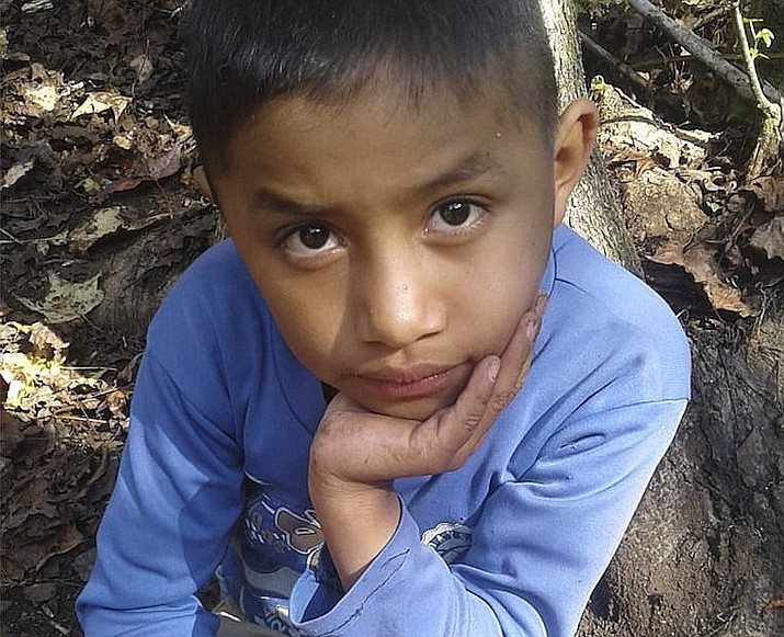 This Dec. 12, 2018 file photo provided by Catarina Gomez on Thursday, Dec. 27, 2018, shows her stepbrother Felipe Gomez Alonzo, 8, near her home in Yalambojoch, Guatemala. Guatemalan authorities said Monday, April 1, 2019, the 8-year-old boy in custody of the U.S. border patrol on Christmas Eve died of the flu and a bacterial infection. (Catarina Gomez via AP, File)