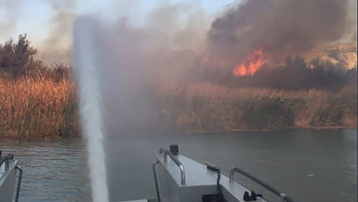 This photo was taken from the San Bernardino County Fire boat as it protected the area near Contact Point on Lake Havasu. (San Bernardino County Fire photo)