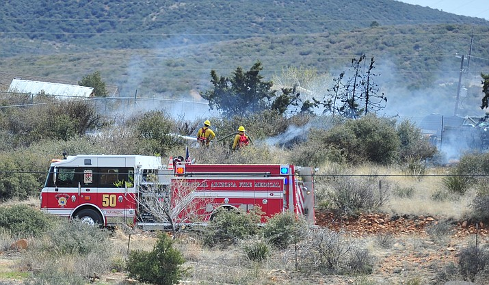 Central Arizona Fire and Medical Authority crews extinguish a wildland fire in the Blue Hills area of Dewey Monday, April 1.