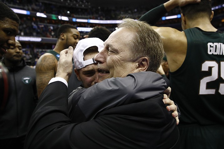 Michigan State head coach Tom Izzo, right, celebrates after an NCAA men's East Regional final college basketball game against Duke, Sunday, March 31, 2019, in Washington. Michigan State won 68-67. (Patrick Semansky/AP)