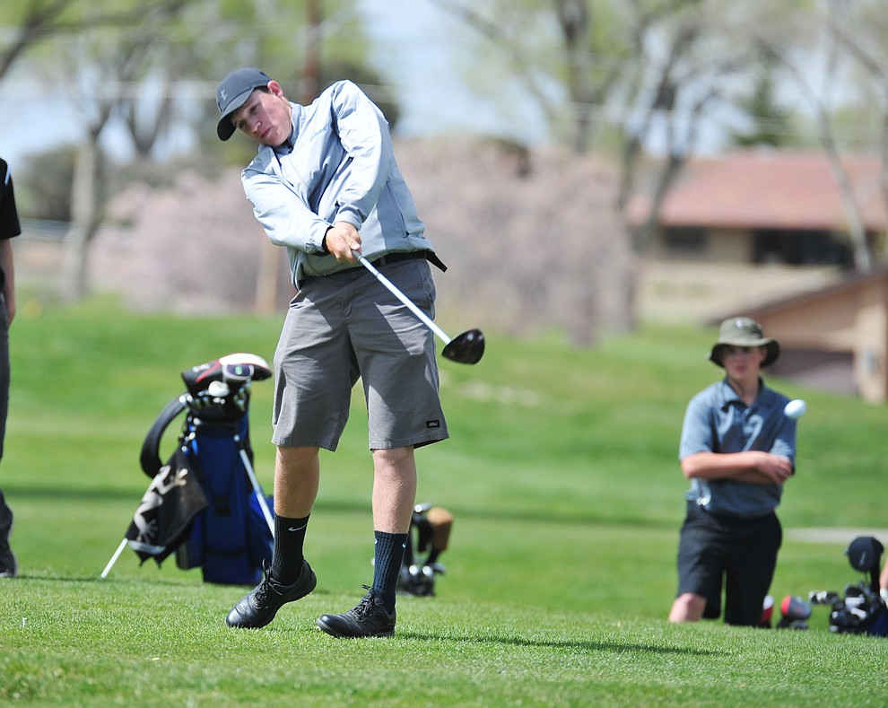 Bagdad's Riley Young tee off as Chino Valley hosted a four-team match Tuesday, April 2 in Prescott. (Les Stukenberg/Courier)