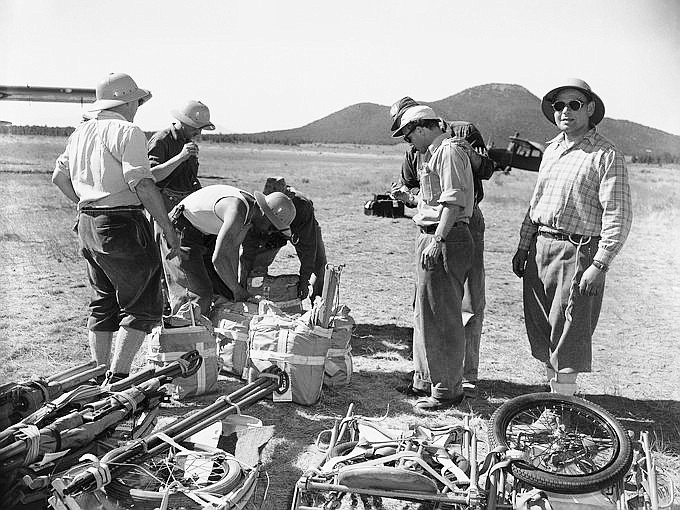 A team of Swiss mountain climbers prepares the gear in an attempt to retrieve remains and wreckage from a plane collision in a remote area of the canyon in 1956. (Photo/Associated Press)