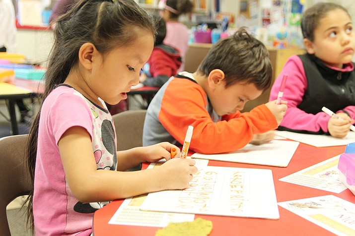 Grand Canyon students practice writing their letters and names during independent writing time. Kindergarten teacher Juliana Fontenot said she frequently divides her teaching objectives based on students' skills, including those who perform under and beyond grade level expectations. (Erin Ford/WGCCN)