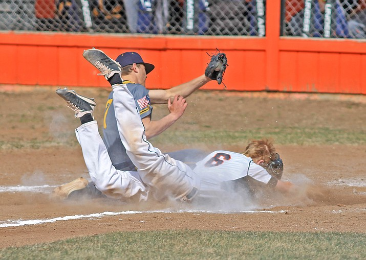 Carsten Brinkworth beats the tag at home plate in the Vikings first home game March 26. (Wendy Howell/WGCN)