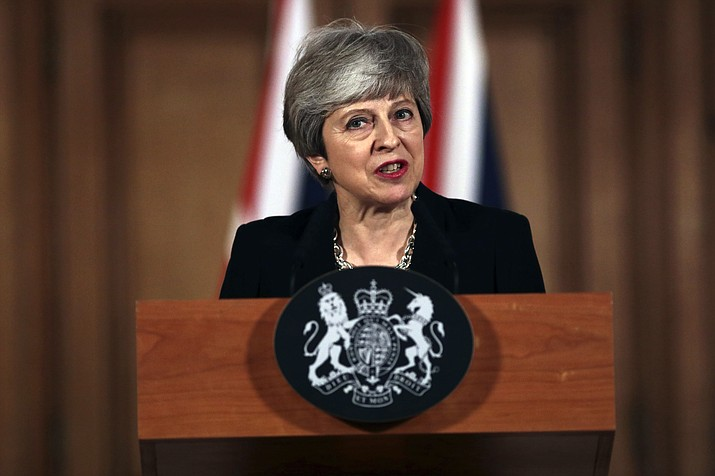 Britain's Prime Minister Theresa May gives a press conference outside Downing Street, in London, Tuesday, April 2, 2019. May said Tuesday that she will seek to further delay Britain's exit from the European Union and seek to make an accord with the political opposition in a bid to break the Brexit impasse. (Jack Taylor/Pool Photo via AP)