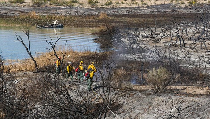 Firefighters put out hot spots in the area near Body Beach on Tuesday morning. (Photo courtesy of Rick Powell via the Today's News-Herald)