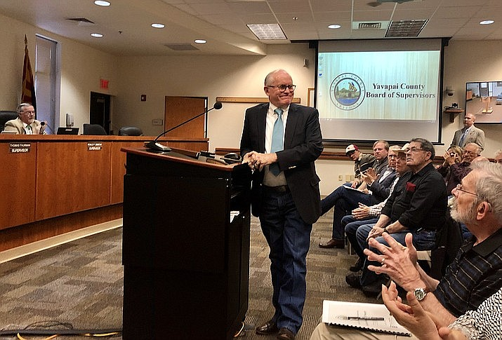 The crowd applauds Wednesday morning, April 3, after longtime Arizona State Sen. Steve Pierce is chosen by the Yavapai County Board of Supervisors to fill the House of Representatives seat vacated last week by David Stringer. (Cindy Barks/Courier)