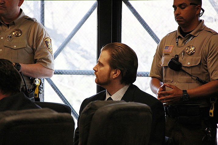 Kenneth Wayne Thompson II listens to a Yavapai County Superior Court clerk read the verdict reached by the jury in his murder case Wednesday, April 3, 2019. (Max Efrein/Courier)