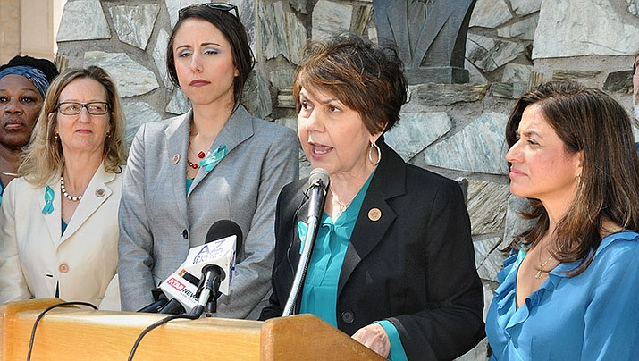 Surrounded by fellow Democrats, House Minority Leader Charlene Fernandez on Wednesday calls on Republican leadership to follow through with its promise to create a code of conduct for lawmakers. (Capitol Media Services photo by Howard Fischer)