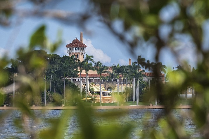 This Nov. 23, 2018 file photo shows President Donald Trump's Mar-a-Lago estate behind mangrove trees in Palm Beach, Fla. On Saturday, March 30, 2019, a woman carrying two Chinese passports and a device containing computer malware lied to Secret Service agents and briefly gained admission to the club over the weekend during his Florida visit, federal prosecutors allege in court documents. (AP Photo/J. David Ake)