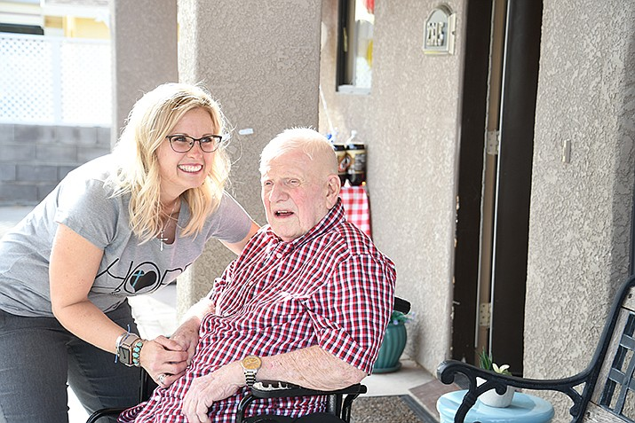 Hope Haven Assisted Living owner Crystal Finch Brown with her first resident at a one-year celebration Wednesday. (Photo by Vanessa Espinoza/Daily Miner)