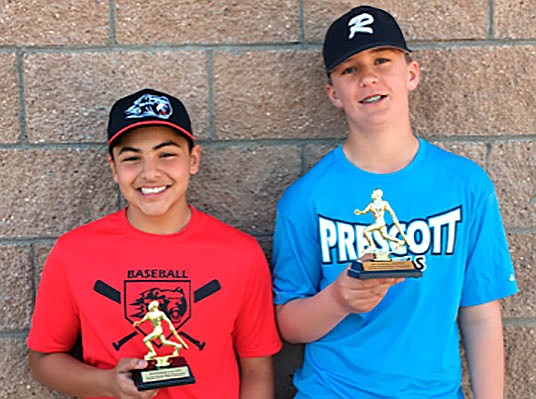 Kishan Patel, left, and Zane Gaul show off their trophies as winners of the third annual Prescott Area Home Run Derby that took place March 31 in Prescott. (Lisa Thunborg/Courtesy)