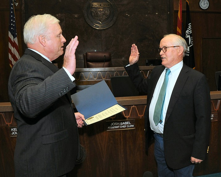 Supreme Court Justice Robert Brutinel, left, swears in Republican Steve Pierce on Wednesday to replace former Rep. David Stringer of Prescott who resigned last week following the release of a police report detailing 1983 charges of paying teen boys for sex. (Capitol Media Services photo by Howard Fischer)
