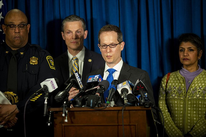 U.S. Attorney Benjamin Glassman answers questions during a news conference regarding Brian Rini, at the U.S. Attorney's Office in downtown Cincinnati Friday, April 5, 2019. Rini, a 23-year-old ex-convict accused of pulling a cruel hoax by pretending to be Timmothy Pitzen, who disappeared in 2011 at age 6, was charged Friday with making false statements to authorities. (Meg Vogel/The Cincinnati Enquirer via AP)