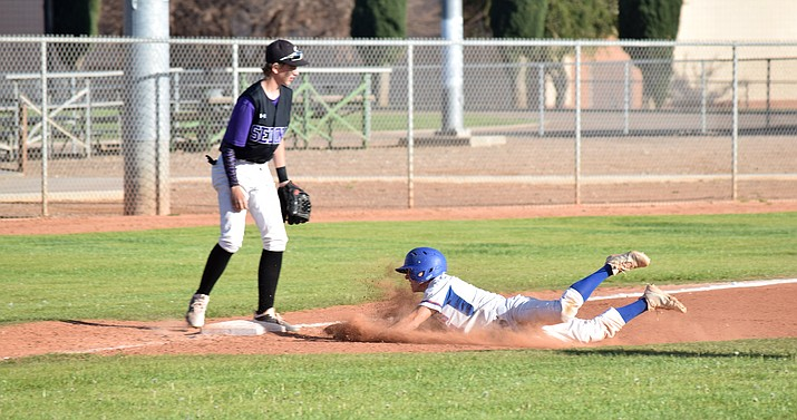 Camp Verde senior Dominiq Bruno slides into third during the Cowboys' 14-2 win over Sedona Red Rock at home on Friday. VVN/James Kelley