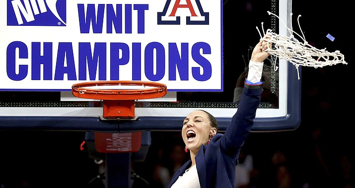 University of Arizona coach Adia Barnes waves the net after the Wildcats defeated Northwestern 56-42 for the WNIT championship Saturday, April 6, 2019, in Tucson. (Kelly Presnell/Arizona Daily Star via AP)