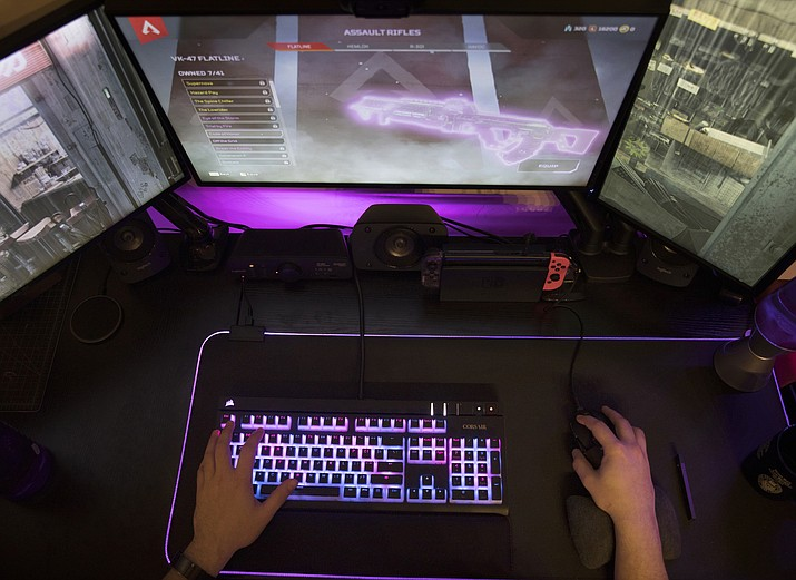 """This Wednesday, March 6, 2019, photo shows a person playing """"Apex Legends"""" in Jersey City, N.J. Electronic Arts' """"Apex Legends"""" got 50 million players worldwide in its first four weeks. (Jenny Kane/AP)"""