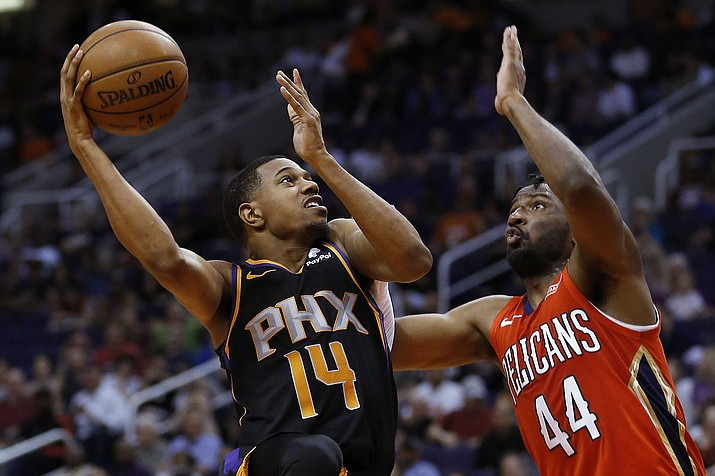 Phoenix guard De'Anthony Melton shoots over New Orleans forward Solomon Hill during the second half Friday, April 5, 2019, in Phoenix. (Rick Scuteri/AP)