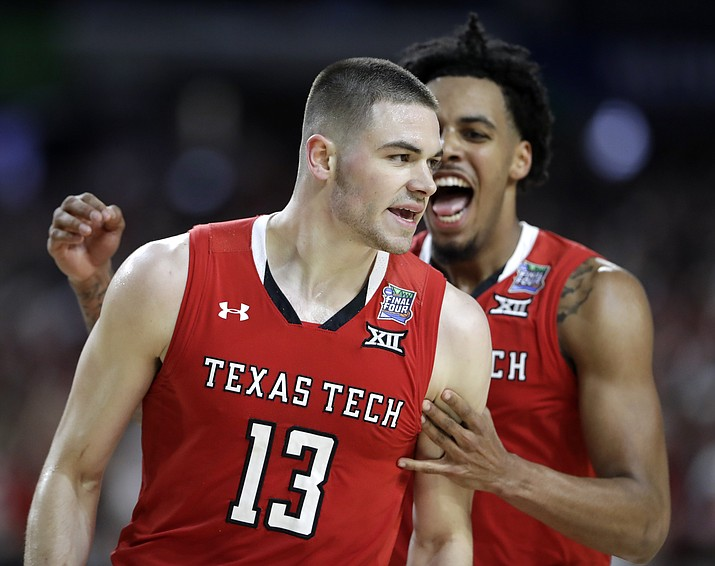 Texas Tech guard Matt Mooney (13) celebrates after making a 3-point basket during the second half against Michigan State in the semifinals of the Final Four , Saturday, April 6, 2019, in Minneapolis. (Jeff Roberson/AP)