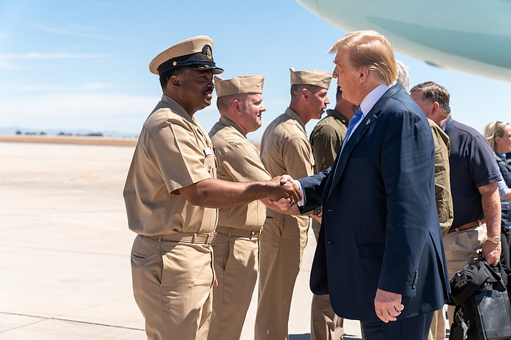 President Donald J. Trump is greeted by state representatives and military personnel on the tarmac at Naval Air Facility El Centro, Calif., Friday, April 5, 2019, on his way to visit the border in Calexico, Calif. (Official White House Photo by Shealah Craighead)