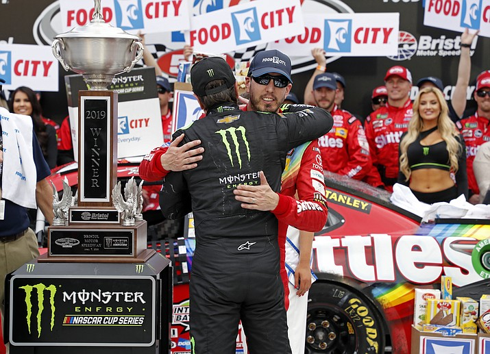 Kyle Busch, facing camera, gets a hug from brother Kurt Busch after winning the NASCAR Cup Series auto race Sunday, April 7, 2019, at Bristol Motor Speedway in Bristol, Tenn. (Wade Payne/AP)