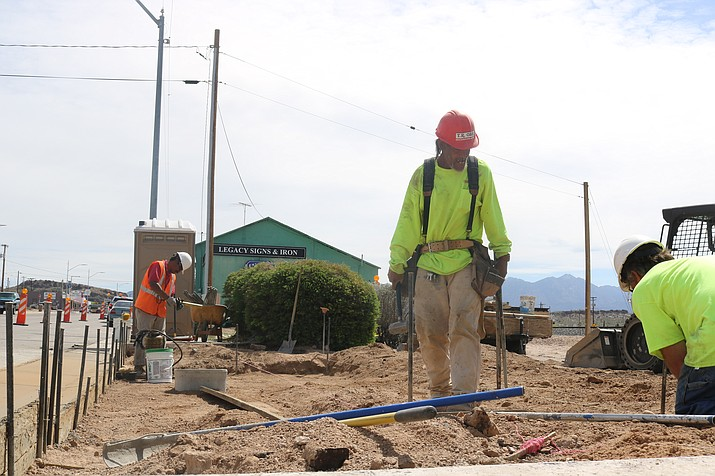 A crew from T. R. Orr Incorporated works on Andy Devine Avenue sidewalk improvements Friday afternoon. (Photo by Travis Rains/Daily Miner)