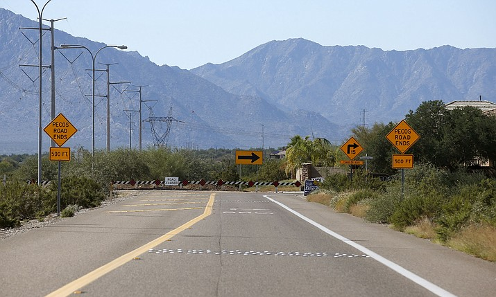 Pecos Road in southern Phoenix. The state Senate voted Thursday to allow a public vote to not just extend the existing half-cent sales tax for roads and transit projects but to double it. (Ross D. Franklin/AP, file)