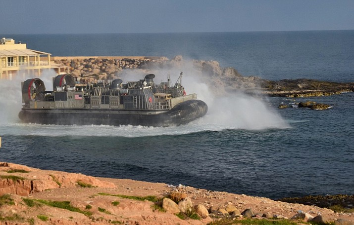 A U.S. amphibious hovercraft departs with evacuees from Janzur, west of Tripoli, Libya, Sunday, April 7, 2019. The United States says it has temporarily withdrawn some of its forces from Libya due to deteriorating security conditions. The pullout comes as a Libyan commander's forces advanced toward the capital of Tripoli and clashed with rival militias. A small contingent of American troops has been in Libya in recent years helping local forces combat Islamic State and al-Qaida militants and protecting diplomatic facilities. (Mohammed Omar Aburas/AP)