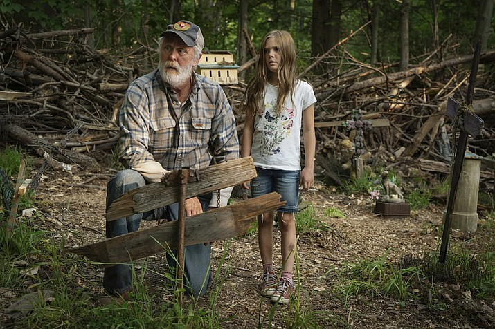 "This image released by Paramount Pictures shows John Lithgow, left, and Jeté Laurence in a scene from ""Pet Sematary."" (Kerry Hayes/Paramount Pictures)"