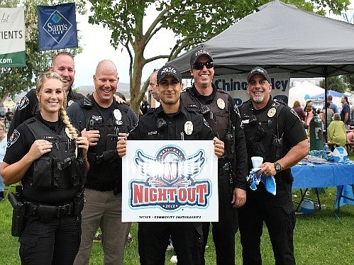 Chances to meet with local law enforcement include the Coffee with Cops event from 8 to 9 a.m. Wednesday, April 24, at Overflow Coffee Shop, 448 N. Highway 89 in Chino Valley. Pictured are some of the town's finest at a National Night Out event. (CVPD/Courtesy)