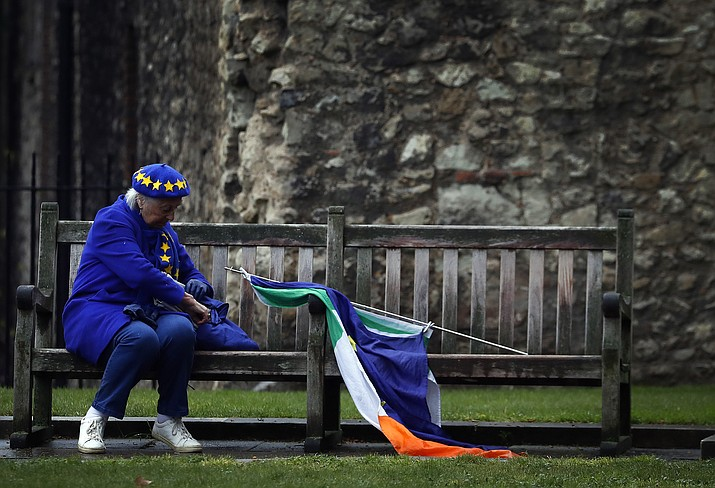 A pro EU protestor takes a rest on a bench opposite the Houses of Parliament in London, Monday, April 8, 2019. Britain's government and opposition party are hoping to find an acceptable compromise Brexit deal, ahead of further talks with European Union leaders later this week.(Frank Augstein/AP)