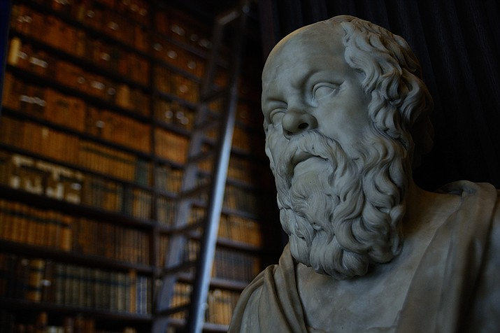 The most commonly defended argument from scholars for why one should pay taxes is a duty of fair play. Fair play is the notion of reciprocity, the idea that you should not take advantage of others. To others, it is as simple as the need to obey the law. Socrates, as depicted at Trinity College above, was one such philosopher. (Photo by Bar Harel [CC BY-SA 4.0])