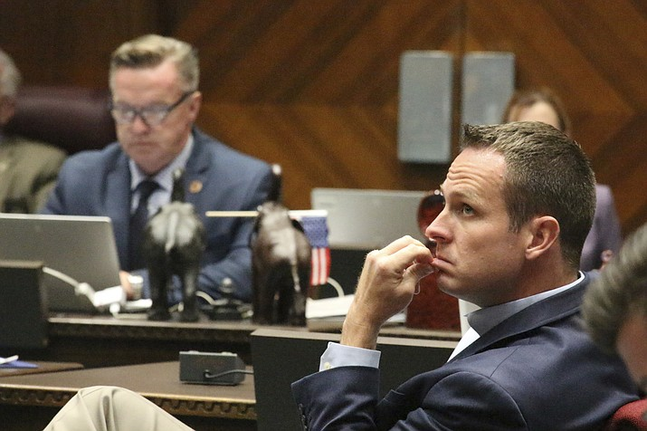Arizona Republican Rep. Travis Grantham, right, looks at the vote board March 22, 2018, in Phoenix. The Senate Rules Committee decided Monday, April 8, 2019, that the proposal by Rep. Travis Grantham, R-Gilbert, would require a three-fourths vote for approval, but fell far short of the 45 needed with 31-29 party-line margin. (Bob Christie/AP, file)