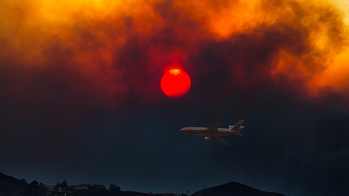 A DC10 Air Tanker is seen over the Woolsey Fire in California Nov. 9, 2018. (Photo courtesy of Peter Buschmann, USDA Forest Service)
